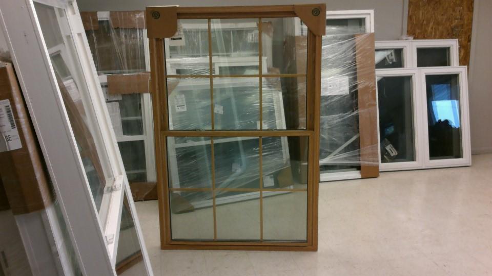Double hung replacement window woodgrain oak screen low-e argon