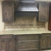 Notty Pine Kitchen Cabinet with upper and lower base cabinets and Granite Counter top included. Also has Another upper Cabinet with Glass Front Cabinet Doors